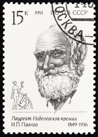physiologist: USSR - CIRCA 1991: A stamp printed in USSR from the Nobel Prize Winners issue shows Ivan Petrovich Pavlov, 1849-1936, circa 1991.