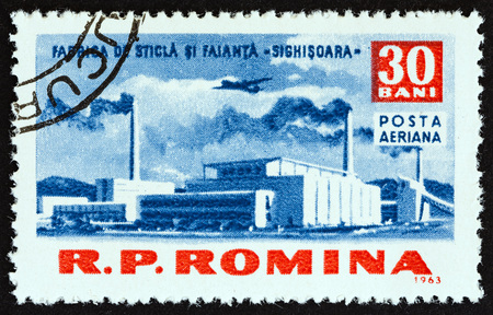 ROMANIA - CIRCA 1963: A stamp printed in Romania from the Socialist Achievements issue shows Sighisoara Glass Factory, circa 1963. Editorial