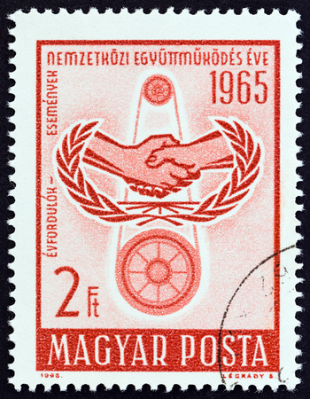 HUNGARY - CIRCA 1965: A stamp printed in Hungary issued for the International Co-operation Year, I.C.Y. shows emblem and pulleys, circa 1965. Editorial