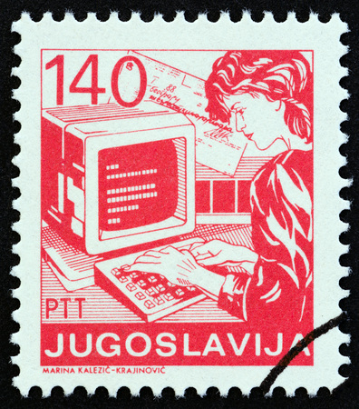 YUGOSLAVIA - CIRCA 1988: A stamp printed in Yugoslavia from the Postal Services issue shows woman working at computer, circa 1988.
