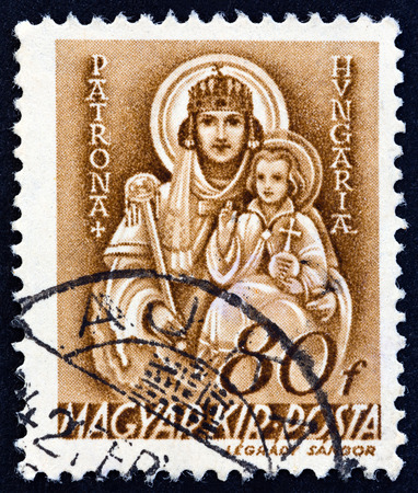iconography: HUNGARY - CIRCA 1941: A stamp printed in Hungary shows Madonna and Child, circa 1941. Editorial