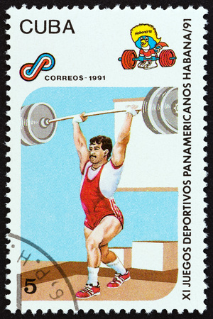 CUBA - CIRCA 1991: A stamp printed in Cuba from the 11th Pan-American Games, Havana issue shows Weightlifting, circa 1991.