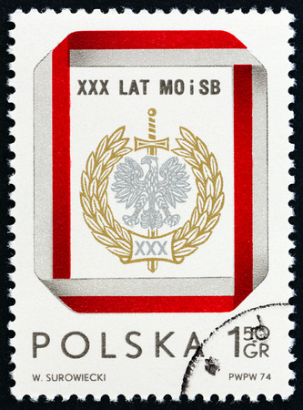 POLAND - CIRCA 1974: A stamp printed in Poland issued for the 30th anniversary of Polish Civic Militia and Security Service shows Civic Militia and Security Service Emblem, circa 1974.