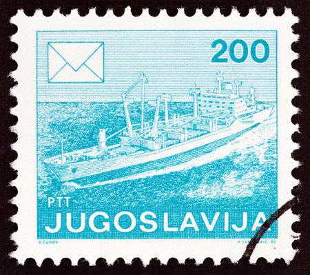 YUGOSLAVIA - CIRCA 1986: A stamp printed in Yugoslavia from the Postal Services issue shows Freighter, circa 1986. Stock Photo - 83120277