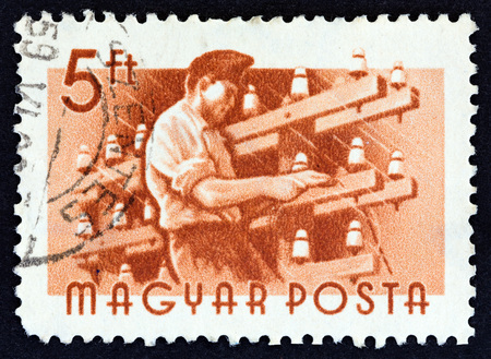 HUNGARY - CIRCA 1955: A stamp printed in Hungary from the Workers issue shows  Telegraph lineman, circa 1955.