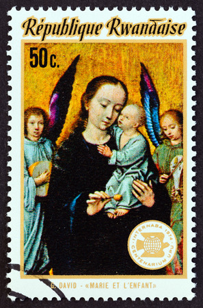 RWANDA - CIRCA 1974: A stamp printed in Rwanda from the International Stamp Exhibitions issue shows Virgin Mary and Child (Gerard David), circa 1974.