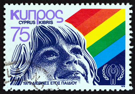 kibris: CYPRUS - CIRCA 1979: A stamp printed in Cyprus issued for the International Year of the Child shows Childs face, circa 1979. Editorial