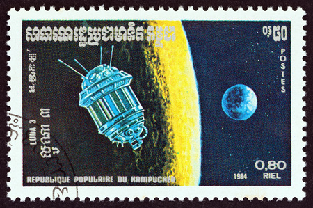 KAMPUCHEA - CIRCA 1984: A stamp printed in Kampuchea from the Space Research issue shows Luna 3, circa 1984.