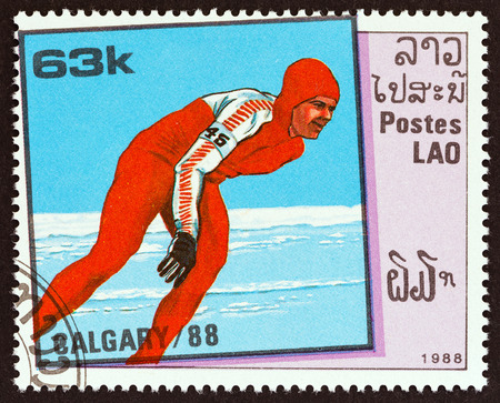 LAOS - CIRCA 1988: A stamp printed in Laos from the Winter Olympic Games, Calgary issue shows Speed skating, circa 1988.
