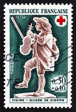 FRANCE - CIRCA 1967: A stamp printed in France from the Red Cross Fund. Ivories in Dieppe Museum issue shows Violinist, circa 1967.