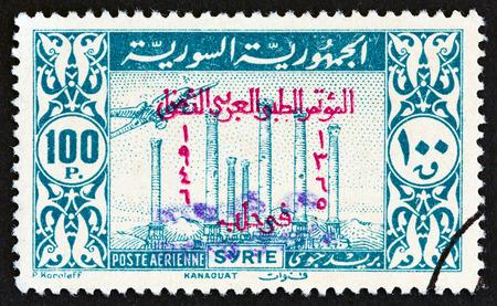 SYRIA - CIRCA 1946: A stamp printed in Syria shows Temple ruins, Kanaouat, circa 1946.