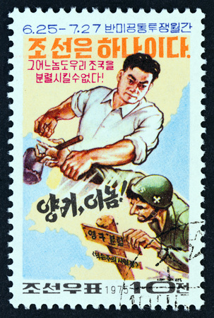 imperialism: NORTH KOREA - CIRCA 1975: A stamp printed in North Korea from the Campaign against U.S. Imperialism issue shows Korean preventing American soldier ramming a border pile, circa 1975.