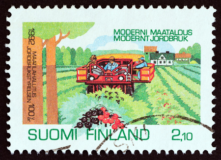 FINLAND - CIRCA 1992: A stamp printed in Finland issued for the centenary of National Board of Agriculture shows Currant Harvesting, circa 1992. Editorial