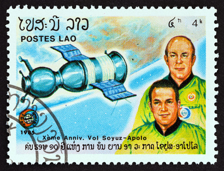 LAOS - CIRCA 1985: A stamp printed in Laos from the 16th anniversary of Apollo-Soyuz Space Link issue shows A. Leonov and V. Kubasov, circa 1985. Editorial