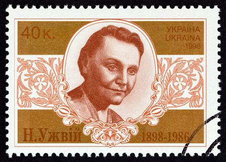 UKRAINE - CIRCA 1998: A stamp printed in Ukraine issued for the 100th anniversary of the birth of Natalia Uzhvii shows actress Natalia Uzhvii, circa 1998.