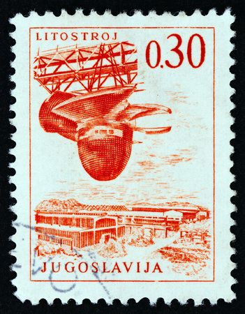 YUGOSLAVIA - CIRCA 1966: A stamp printed in Yugoslavia from the Engineering & Architecture issue shows shipbuilding, circa 1966.