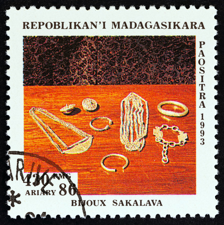MADAGASCAR - CIRCA 1994: A stamp printed in Madagascar from the Handicraft issue shows Silver jewellery on table, Sakalava, circa 1994.