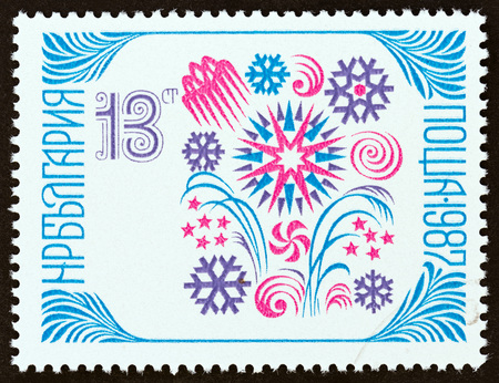 BULGARIA - CIRCA 1986: A stamp printed in Bulgaria from the New Year issue shows Fireworks and snowflakes, circa 1986.