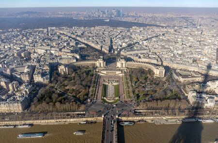 Panoramic view of Paris from Eiffel tower towards the Jardins du Trocadero, the skytowers of Courbevoie in the background.