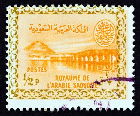 SAUDI ARABIA - CIRCA 1960: A stamp printed in Saudi Arabia shows Wadi Hanifa Dam, near Riyadh, circa 1960. Editoriali