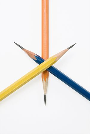 Extremely sharpened crossed pencils over white background