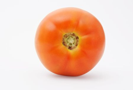Red tomato frontal close-up isolated over white background