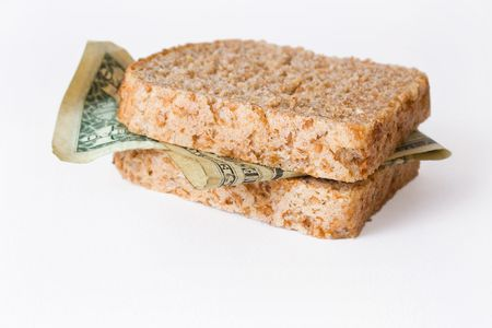 Dollar banknotes between two slices of wholemeal bread isolated on white background Stock Photo