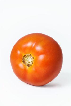 Tomato close-up isolated over white background
