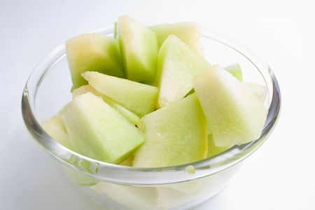 Melon honeydew pieces in a glass bowl