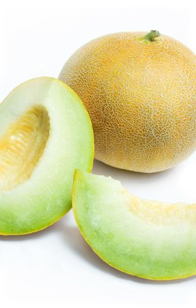 Ripe melon honeydew and two melon slices isolated on white background