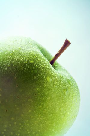 Green apple isolated on blue gradient background
