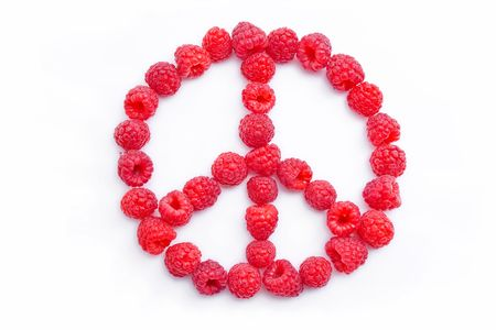 Raspberries arranged in the shape of the symbol of peace