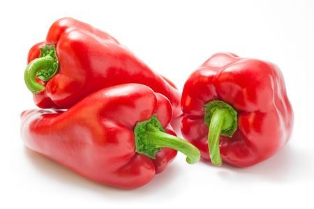Peppers. Red big ripe peppers close-up isolated on white background