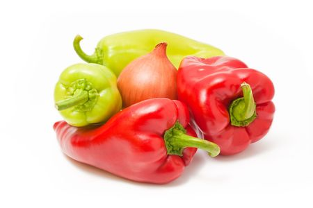 Fresh ripe red and green peppers with onion isolated on white background