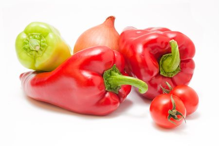 Fresh ripe red and green peppers with onion and cherry-tomatoes isolated on white background photo