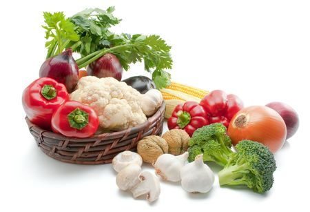 Vegetables. Mix of fresh ripe vegetables arranged in a wicker basket and around isolated on white background