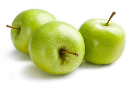 Apples. Three fresh ripe green apples close up isolated on white background