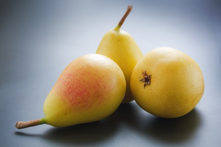 Pears. Three ripe juicy pears close-up arranged on gradient background
