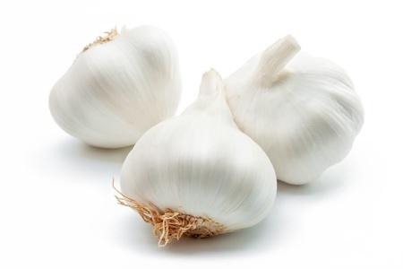 Garlic. Three cloves of garlic arranged on a white background close-up