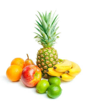 Fruits. Arrangement of various fresh ripe fruits: pineapple, bananas, oranges, pear, apple and limes  isolated on white background. Stock Photo