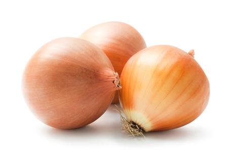 Onion. Arrangement of three ripe fresh onions isolated on white background