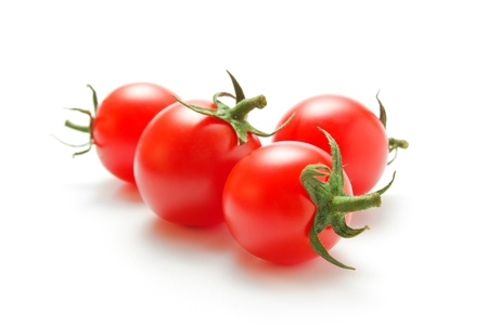 Fresh ripe cherry tomatoes closeup  isolated on white background Stock Photo