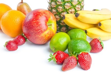 Fruits. Arrangement of various fresh ripe fruits: pineapple, bananas, oranges, apple, pear,  limes and strawberries closeup  isolated on white background Stock Photo
