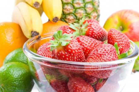Arrangement of various fresh ripe fruits isolated on white background.