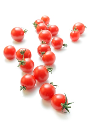Cherry tomatoes. Fresh ripe cherry tomatoes scattered isolated on white background.