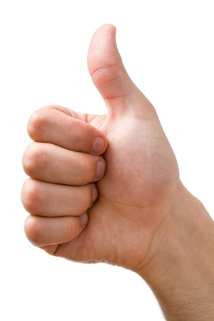 Hand showing thumbs up sign close-up isolated on white background.