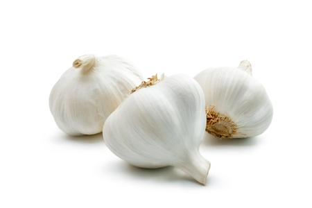 Garlic. Three cloves of garlic arranged on a white background close-up.