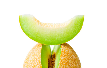 HONEYDEW: Ripe fresh melon honeydew and a slice over it closeup  isolated on white background Stock Photo