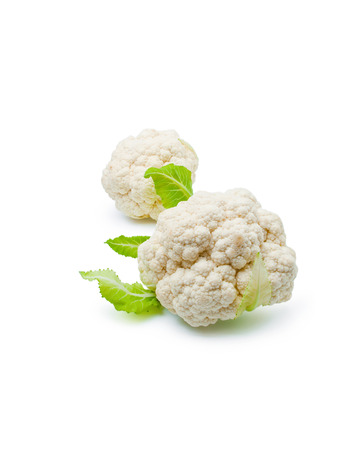 Two fresh ripe whole cauliflower cabbages close-up isolated on white background