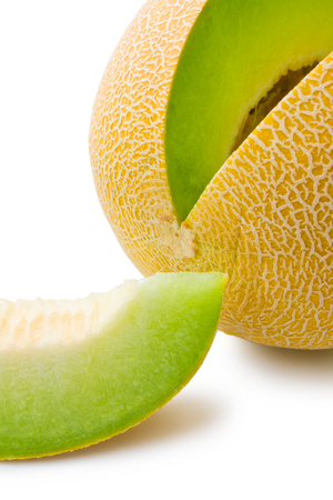 Melon honeydew and melon slice. Ripe fresh melon honeydew and a slice close-up isolated on white background